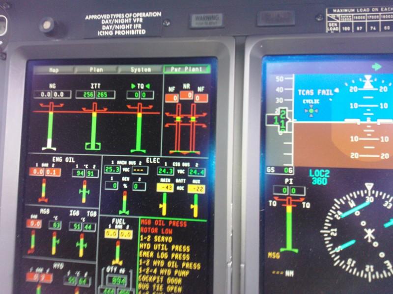 un moderno pannello di controllo con strumentazione aeronautica
